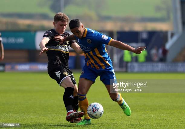 Ryan Cooney of Bury and Max Lowe of Shrewsbury Town during the Sky Bet League One match between Shrewsbury Town and Bury at New Meadow on April 21...