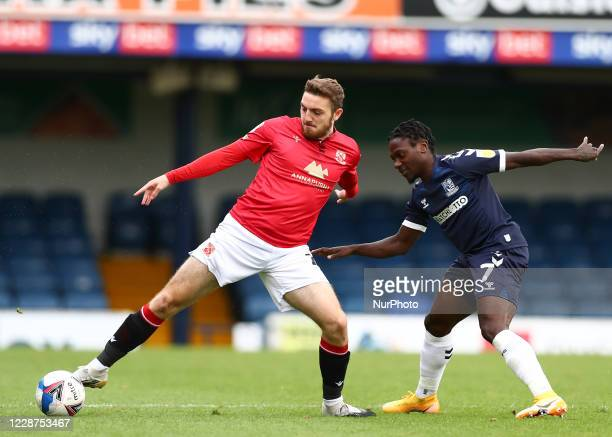 Ryan Cooney of Morecambe and Jordan Green of Southend United battling for possession during the Sky Bet League 2 match between Southend United and...