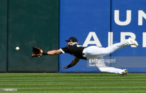 Ryan Cordell of the Chicago White Sox can't make a catch on a double hit by Jonathan Schoop of the Minnesota Twins during the second inning at...