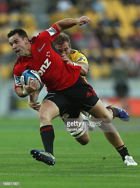 Ryan Cotty of the Crusaders is tackled during the round four Super Rugby match between the Hurricanes and the Crusaders at Wellington Regional...