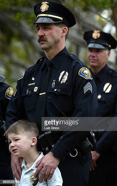Ryan Coy joins his father Sgt Kevin Coy at the Long Beach Police and Fire Memorial Service on Tuesday May 7 in the Long Beach Civic Center The event...