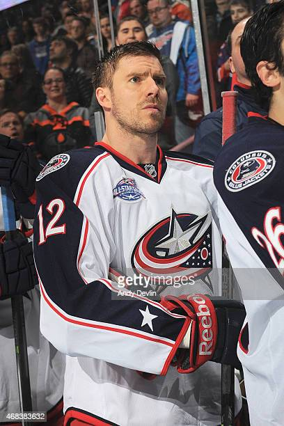 Ryan Craig of the Columbus Blue Jackets stands for the singing of the national anthem prior to the game against the Edmonton Oilers on March 18 2015...