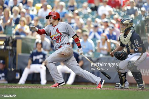 Ryan Craig of the St Louis Cardinals makes some contact at the plate during the game against the Milwaukee Brewers at Miller Park on July 13 2014 in...