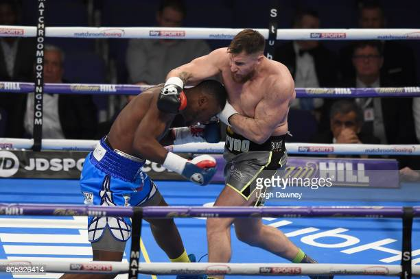 Ryan Crawford in boxing action with Isaac Chamberlain during a Cruiserweight contest at The O2 Arena on July 1 2017 in London England