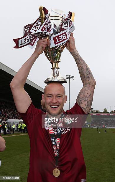 Ryan Cresswell of Northampton Town celebrates with the Sky Bet League Two champions trophy after the Sky Bet League Two match between Northampton...