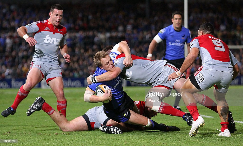 Ryan Cross of the Force gets tackled by Richie McCaw of the Crusaders during the round 11 Super 14 match between the Western Force and the Crusaders at ME Bank Stadium on April 23, 2010 in Perth, Australia.