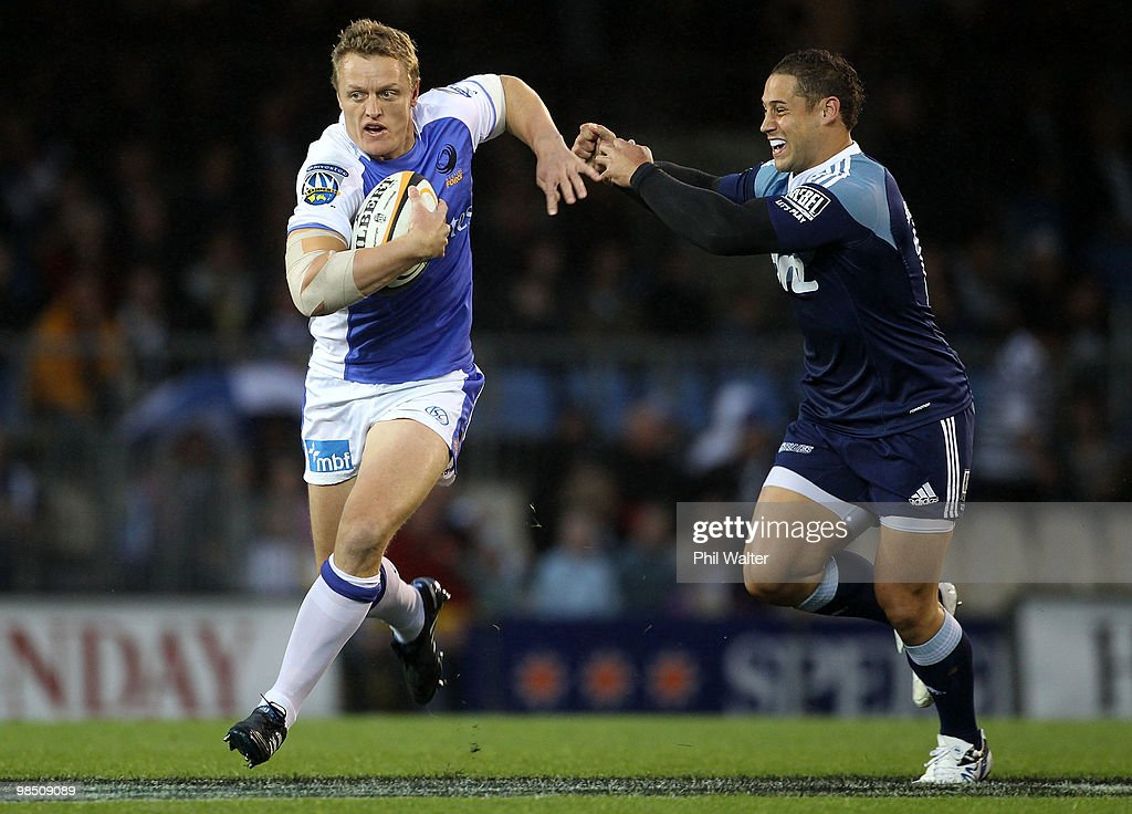 Ryan Cross of the Force is tackled by Luke McAlister of the Blues during the round 10 Super 14 match between the Blues and the Western Force at Eden Park on April 17, 2010 in Auckland, New Zealand.