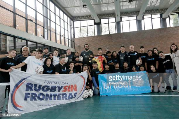 Ryan Crotty Anton Lienert Brown Tim Perry and Sam Whitelock of New Zealand All Blacks pose for pictures during a sports clinic with a teenage rugby...