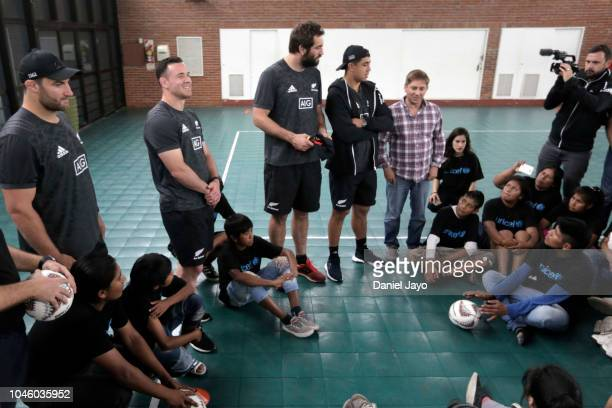 Ryan Crotty Anton Lienert Brown Tim Perry and Sam Whitelock of New Zealand All Blacks speak to children at the end of a sports clinic with a teenage...