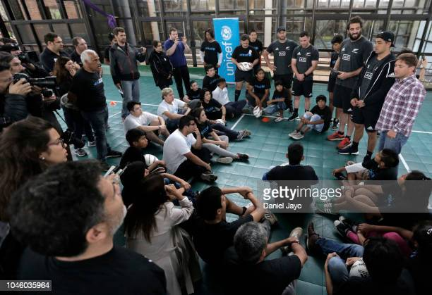 Ryan Crotty Anton Lienert Brown Tim Perry and Sam Whitelock of New Zealand All Blacks speak to children at the end of a a sports clinic with a...