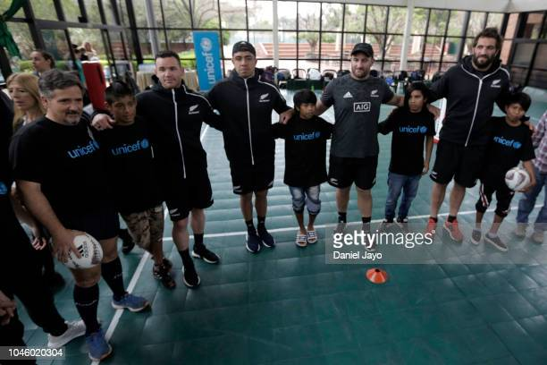 Ryan Crotty Anton Lienert Brown Tim Perry Sam Whitelock of New Zealand All Blacks attend a a sports clinic with a teenage rugby team of the...