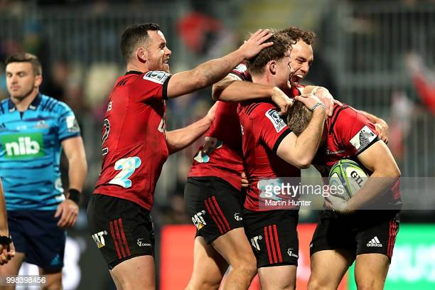 Ryan Crotty Israel Dagg Mitchell Drummond and Jack Goodhue all of the Crusaders celebrate after scoring a try during the round 19 Super Rugby match...