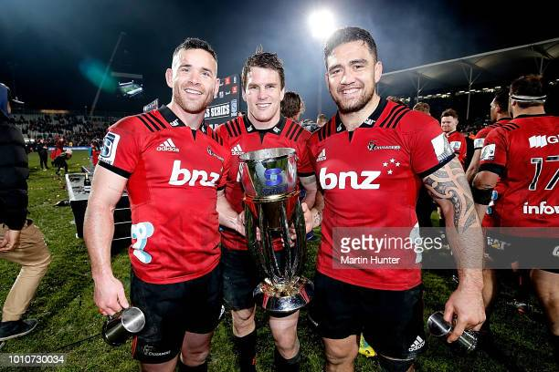 Ryan Crotty Matt Todd and Codie Taylor all of the Crusaders celebrate after the Super Rugby Final match between the Crusaders and the Lions at AMI...