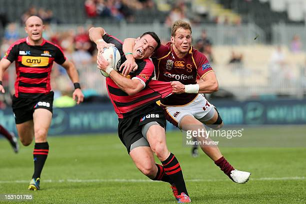 Ryan Crotty of Canterbury is tackled around the neck by Marty McKenzie of Southland during the round 11 ITM Cup match between Canterbury and...