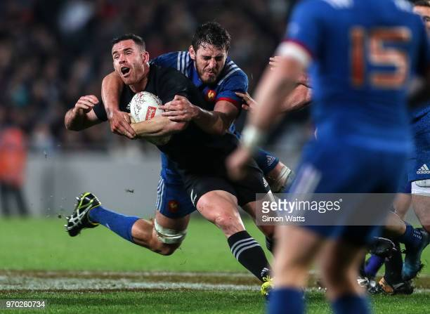 Ryan Crotty of New Zealand is tackled high by Paul Gabrillagues of France during the International Test match between the New Zealand All Blacks and...