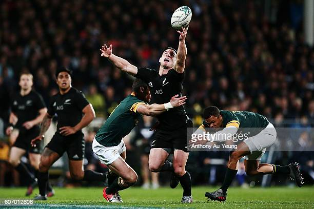 Ryan Crotty of New Zealand knocks the ball on while being tackled by Jesse Kriel of South Africa during the Rugby Championship match between the New...