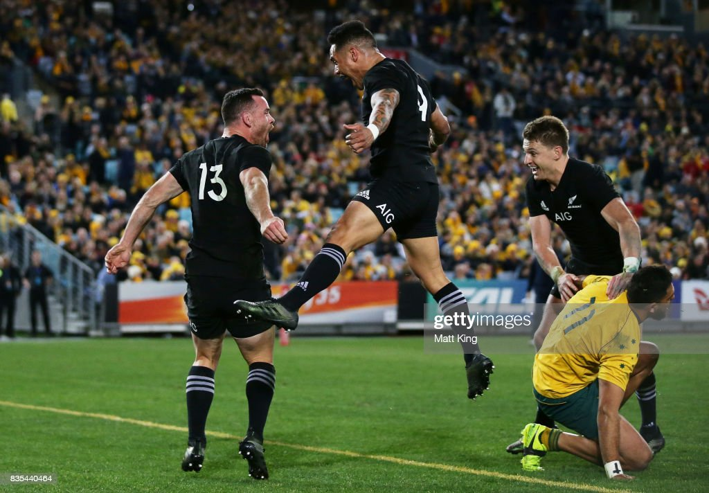 Ryan Crotty of the All Blacks (L) celebrates with team mates Aaron Smith (C) and Beauden Barrett (R) after scoring a try during The Rugby Championship Bledisloe Cup match between the Australian Wallabies and the New Zealand All Blacks at ANZ Stadium on August 19, 2017 in Sydney, Australia.