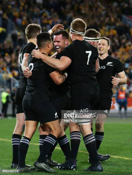 Ryan Crotty of the All Blacks celebrates with team mates after scoring a try during The Rugby Championship Bledisloe Cup match between the Australian...