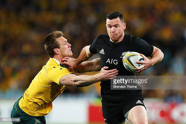 Ryan Crotty of the All Blacks fends off Dane HaylettPetty of the Wallabies during the Bledisloe Cup Rugby Championship match between the Australian...