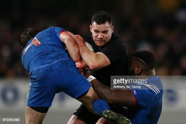 Ryan Crotty of the All Blacks is tackled during the International Test match between the New Zealand All Blacks and France at Eden Park on June 9...