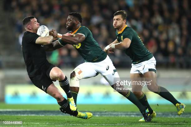 Ryan Crotty of the All Blacks is tackled during The Rugby Championship match between the New Zealand All Blacks and the South Africa Springboks at...