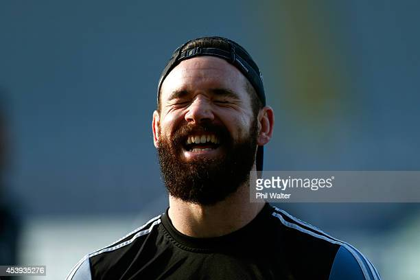 Ryan Crotty of the All Blacks laughs during the New Zealand All Blacks Captain's Run at Eden Park on August 22 2014 in Auckland New Zealand
