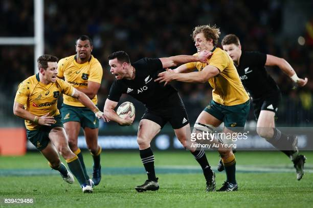 Ryan Crotty of the All Blacks on the charge against Ned Hanigan of the Wallabies during The Rugby Championship Bledisloe Cup match between the New...