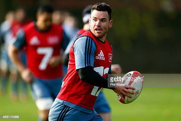 Ryan Crotty of the All Blacks passes during the New Zealand All Blacks training session at Sophia Gardens on November 18 2014 in Cardiff Wales