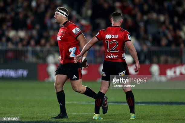 Ryan Crotty of the Crusaders acknowledges Wyatt Crockett as he runs out onto the field for his 200th appearance for the Crusaders during the round 18...