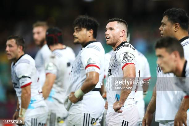 Ryan Crotty of the Crusaders and his team look dejected after a Waratahs try during the round six Super Rugby match between the Waratahs and the...