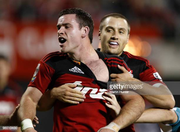 Ryan Crotty of the Crusaders celebrates after scoring a try with team mate Tim Bateman during the round 10 Super 14 match between the Crusaders and...