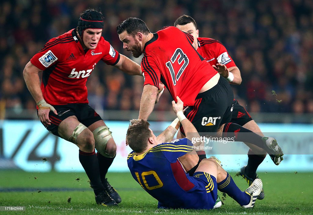Ryan Crotty of the Crusaders is tackled by Colin Slade of the Highlanders during the round 18 Super Rugby match between the Highlanders and the Crusaders at Forsyth Barr Stadium on June 29, 2013 in Dunedin, New Zealand.