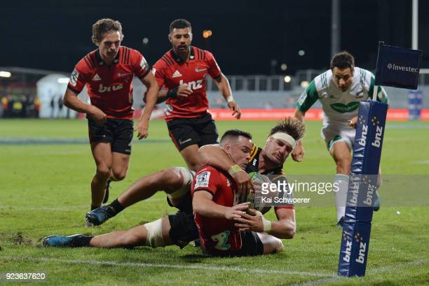Ryan Crotty of the Crusaders is tackled by Lachlan Boshier of the Chiefs during the round two Super Rugby match between the Crusaders and the Chiefs...