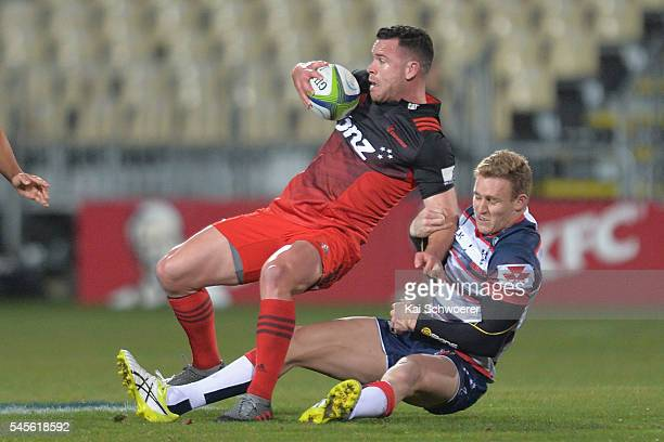 Ryan Crotty of the Crusaders is tackled by Reece Hodge of the Rebels during the round 16 Super Rugby match between the Crusaders and the Rebels at...