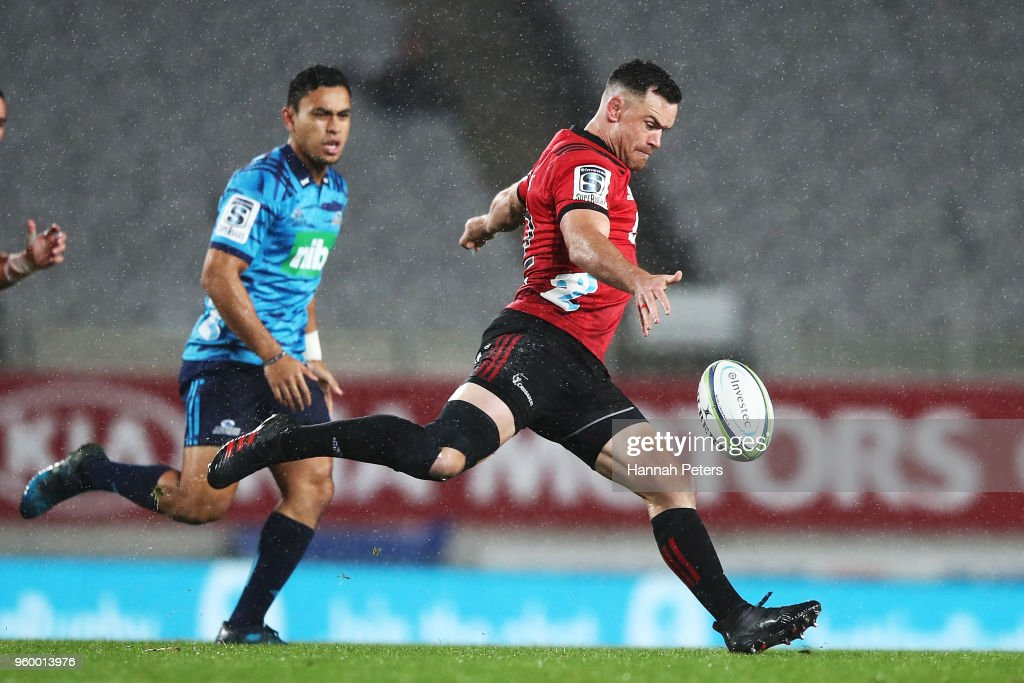 Ryan Crotty of the Crusaders kicks the ball through during the round 14 Super Rugby match between the Blues and the Crusaders at Eden Park on May 19, 2018 in Auckland, New Zealand.