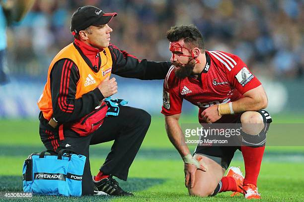 Ryan Crotty of the Crusaders receives treatment during the Super Rugby Grand Final match between the Waratahs and the Crusaders at ANZ Stadium on...