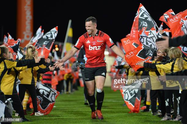 Ryan Crotty of the Crusaders runs out for his 150th Super Rugby match during the round 17 Super Rugby match between the Crusaders and the Rebels at...