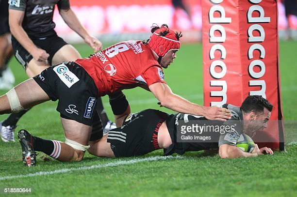 Ryan Crotty of the Crusaders scores during the Super Rugby match between Emirates Lions and Crusaders at Emirates Airline Park on April 01 2016 in...