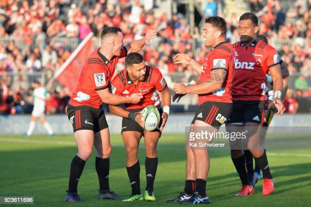 Ryan Crotty Richie Mo'unga Codie Taylor and Seta Tamanivalu of the Crusaders celebrate after Richie Mo'unga scored a try during the round two Super...