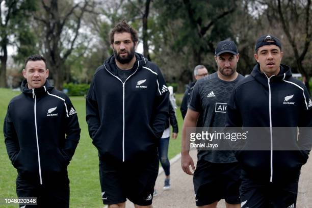 Ryan Crotty Sam Whitelock Tim Perry and Anton Lienert Brown of New Zealand All Blacks arrive to a sports clinic with a teenage rugby team of the...