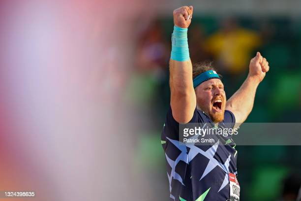 Ryan Crouser celebrates in the Men's Shot Put final after throwing for a world record of 23.37 meters during day one of the 2020 U.S. Olympic Track &...