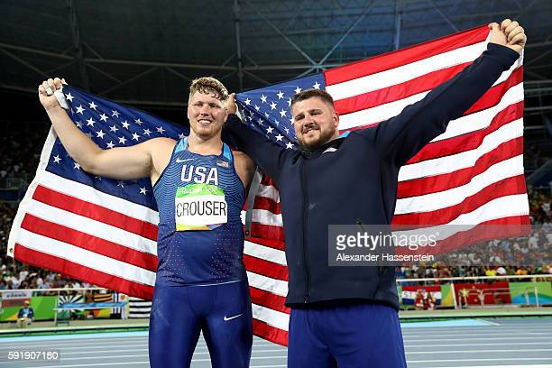 Ryan Crouser of the United States celebrates winning gold and setting a new Olympic record of 2252 with silver medalist Joe Kovacs of the United...