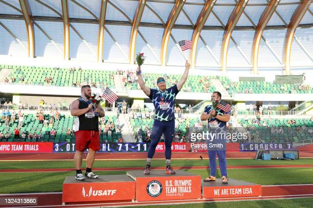 Ryan Crouser reacts on the podium after throwing for a world record of 23.37 meters in the Men's Shot Put final during day one of the 2020 U.S....