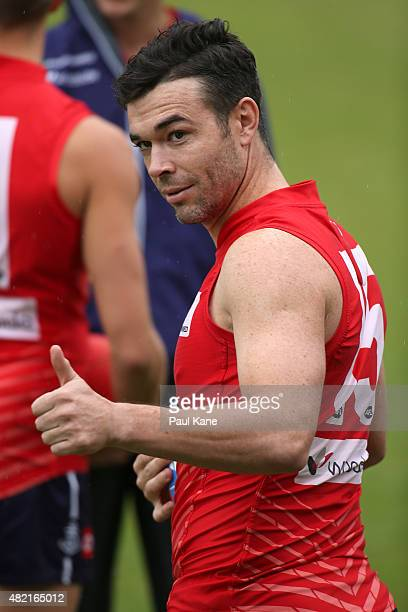 Ryan Crowley gives the thumbs up to supporters after walking onto the oval during a Fremantle Dockers AFL training session at Fremantle Oval on July...