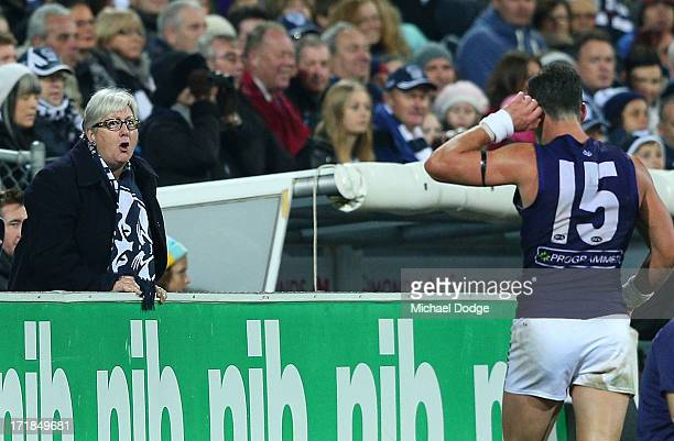 Ryan Crowley of the Dockers reacts to an angry Cats fan during the round 14 AFL match between the Geelong Cats and the Fremantle Dockers at Simonds...