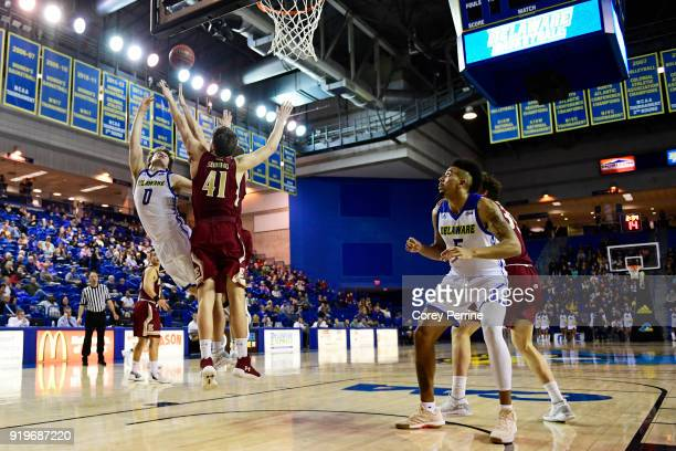 Ryan Daly of the Delaware Fightin Blue Hens drives to the basket against Tyler Seibring of the Elon Phoenix during the first half at the Bob...