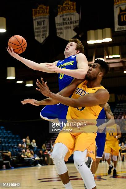 Ryan Daly of the Delaware Fightin Blue Hens is fouled by Austin Williams of the Drexel Dragons during the first half at the Daskalakis Athletic...