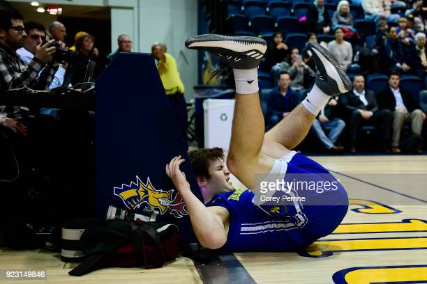 Ryan Daly of the Delaware Fightin Blue Hens lands hard out of bounds after being fouled by the Drexel Dragons during the first half at the Daskalakis...