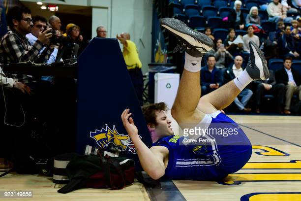 Ryan Daly of the Delaware Fightin Blue Hens lands hard out of bounds during the first half at the Daskalakis Athletic Center on February 22 2018 in...