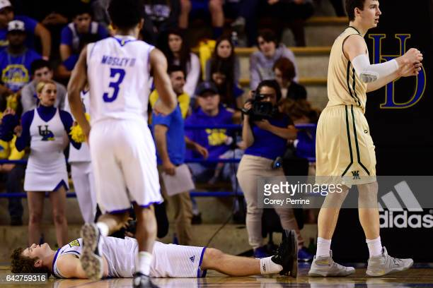 Ryan Daly of the Delaware Fightin Blue Hens lays on his back after losing his footing against Greg Malinowski of the William Mary Tribeduring the...
